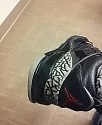 Black and gray Air Jordan basketball shoes Grove City, 43123