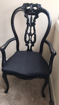 ( 5 Available ) Black wooden framed gray padded armchair . Niles, 60016