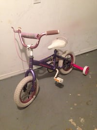 Toddler's purple and white bicycle with training wheels .Size 12 Winnipeg, R2M 1S2