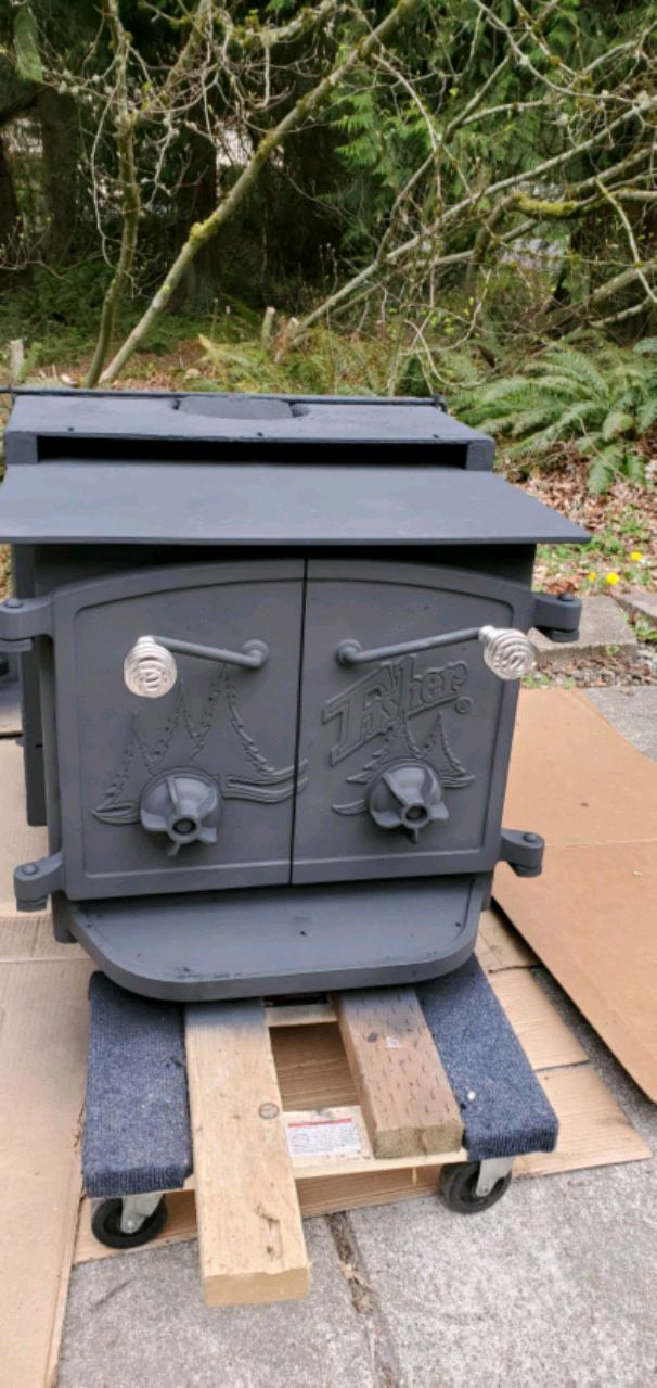 Photo Fisher wood stove with all flashing and hearth in great shape