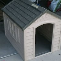 """Dog House.  Hardly used.  25"""" wide x 34 1/2""""deep.  door size: 22"""" high Boise, 83716"""