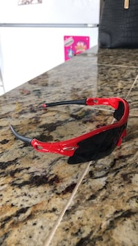 Red and black-framed oakley sport sunglasses