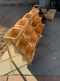 Handmade wheel barrow planter boxes