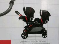 baby's black and red stroller Toronto, M9L 2Y7