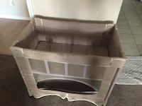 Baby's gray travel cot