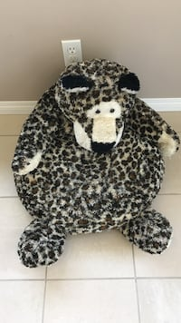 white and brown animal plush toy 3131 km