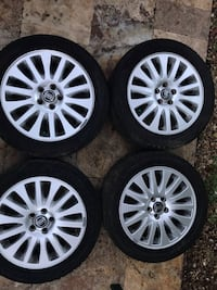 Set of Volvo 225/50R17 Silver 5 lug rims and tires  Valrico, 33596