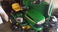 green and yellow John Deere ride on lawn mower Rogers, 72758