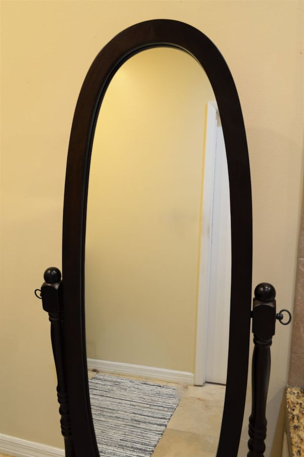 Beautiful cherry cheval-style mirror for traditional decor, tilts for full-body reflection ca2f78ac-a24d-423a-8c64-2cf0e188392a