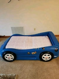 blue and white Little Tikes car bed frame 309 mi