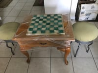 brown wooden table with two chairs Sarasota, 34240