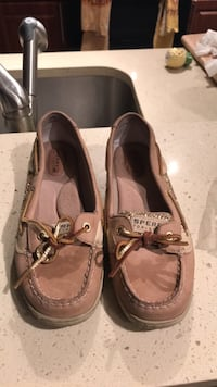 Pair of brown leather boat shoes size 7 Boca Raton, 33486