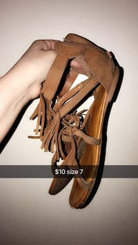 pair of women's brown fringe sandals with text overlay Anderson, 96007
