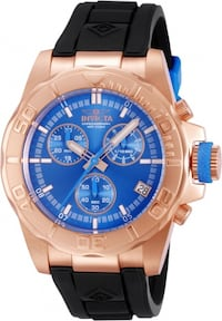 round blue chronograph watch with silver link bracelet
