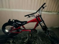 red and black full-suspension mountain bike