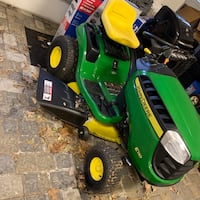 green and yellow John Deere ride on lawn mower Sterling, 20164
