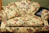 two white-and-pink floral fabric sofa chairs