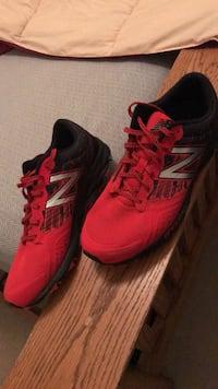 pair of red Adidas running shoes