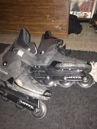 Pair gray-and-black roller blades 1957 km