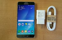 black Samsung Galaxy Note 5 with charger