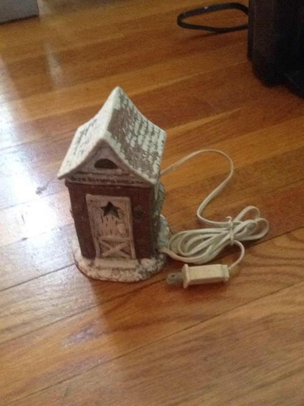 brown and white wooden house miniature