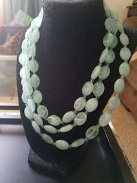 three white beaded necklaces