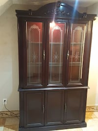 brown wooden wall unit plus table and 4 chairs