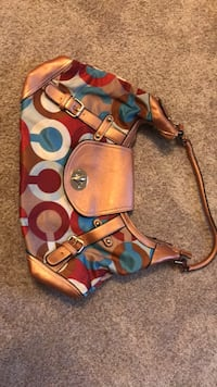 Blue, red, and white leather Coach bag 41 km