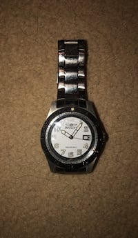Round black and white analog watch with silver link bracelet Winnipeg, R3T 2P8