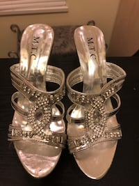 pair of silver open toe ankle strap heels Surrey