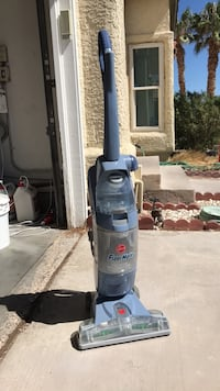 Blue and black bissell upright vacuum cleaner 2062 mi