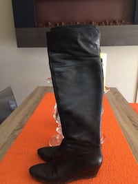 pair of black leather knee-high boots Laval, H7G 0B5