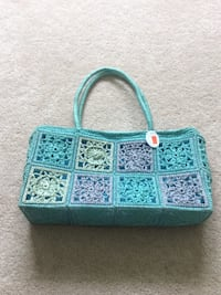 green and purple knitted tote bag