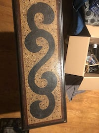brown and black wooden wall decor 21 mi
