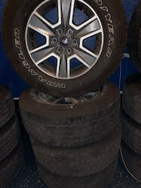 gray Ford 6-spoke vehicle wheel and tire set Plant City, 33563