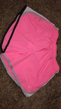 pink and white Nike shorts 1465 mi