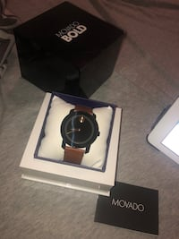 round black Movado analog watch with box 539 km