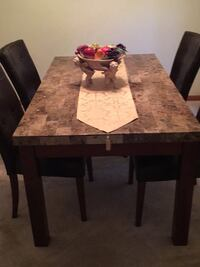 Tablegranit table 4 leather chairs Winter Springs, 32708