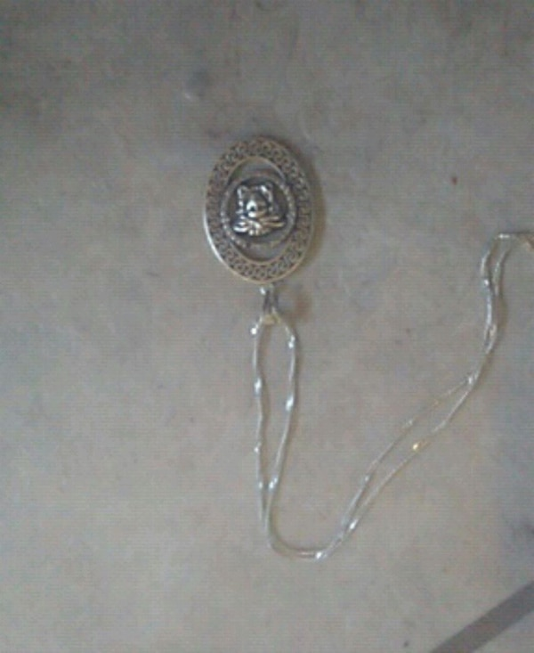 Versace pendant  with sliver necklace
