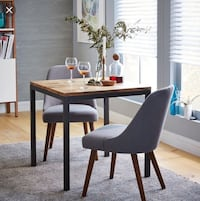 West Elm box frame dining table and leather slope chairs