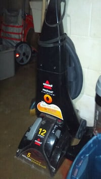 black and red Bissell upright vacuum cleaner Saint Paul, 55106