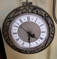 Elegant standing clock. Clock faces on both sides.