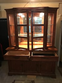2-pc China cabinet with light.   Price is negotiable.