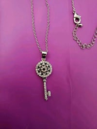 silver-colored necklace with pendant 3161 km