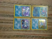 four assorted Pokemon trading cards Bakersfield, 93308