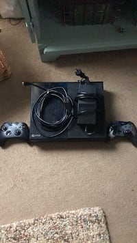 Black Xbox one two controllers  Syracuse