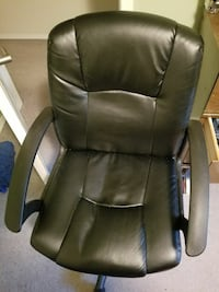 black leather rolling armchair