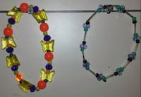 red, green, and blue beaded bracelets  1213 mi