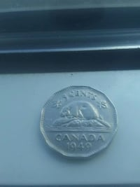 round silver-colored coin Vancouver, V5T 3P7