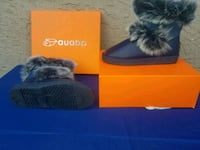 black and gray fur-lined snow boots on box Surrey, V3T 3Y4